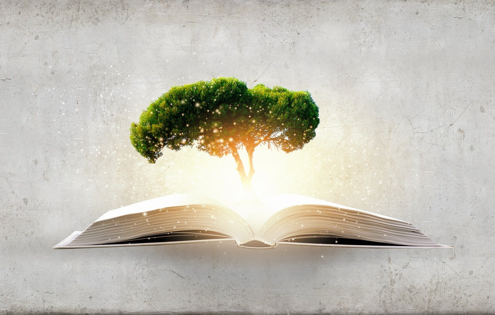 Concept of education and knowledge with tree growing from book